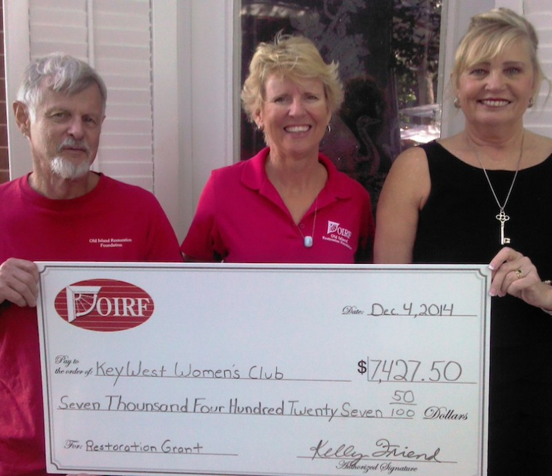 Roberta Spencer, President of the Key West Woman's Club, receives a check from John Johnson and Kelly Friend of the OIRF.  Funds were needed to improve storm protection for the Hellings House, home of the KWWC since 1940.